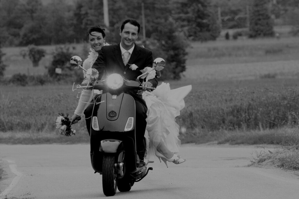 elope in Italy driving a vespa